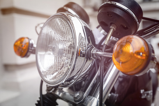 Do I need to have my motorcycle headlight on during the day?
